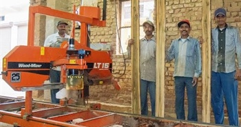 Wood-Mizer LT15 sawmill in New Delhi, India cutting teak...