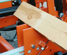 Sawmill bed attachment for creating octagon-shaped beams