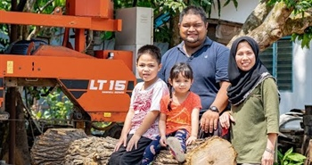 Schoolteacher Reclaiming Wood in Malaysia with...